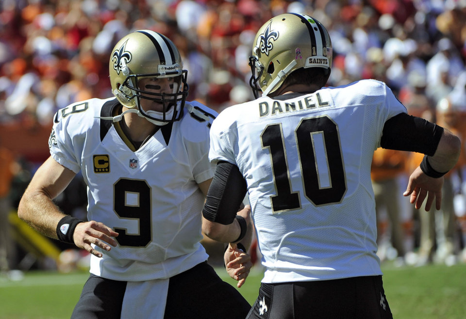 Photo -   New Orleans Saints quarterback Drew Brees (9) celebrates with backup quarterback Chase Daniel (10) after throwing a touchdown pass to tight end David Thomas against the Tampa Bay Buccaneers during the second quarter of an NFL football game on Sunday, Oct. 21, 2012, in Tampa, Fla. (AP Photo/Brian Blanco)