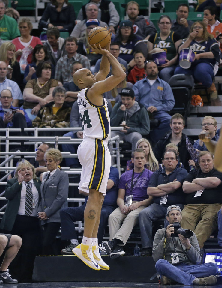 Photo - Utah Jazz's Richard Jefferson (24) shoots against the Orlando Magic in the first quarter during an NBA basketball game on Saturday, March 22, 2014, in Salt Lake City. (AP Photo/Rick Bowmer)