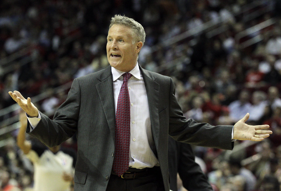 Photo - Philadelphia 76ers head coach Brett Brown questions an official's call during the second half of an NBA basketball game against the Houston Rockets, Thursday, March 27, 2014, in Houston. Houston won 120-98. (AP Photo/Bob Levey)
