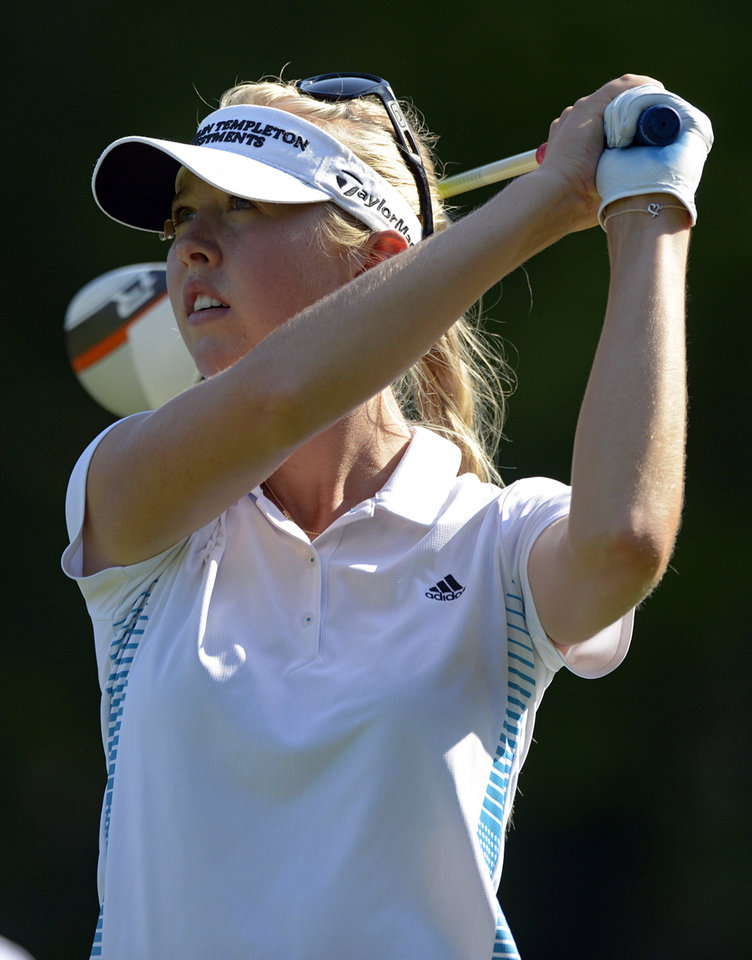 Photo - Jessica Korda watches the flight of her tee shot on the 18th hole in the final round of the Airbus LPGA Classic golf tournament at Magnolia Grove on Sunday, May 25, 2014, in Mobile, Ala. (AP Photo/G.M. Andrews)