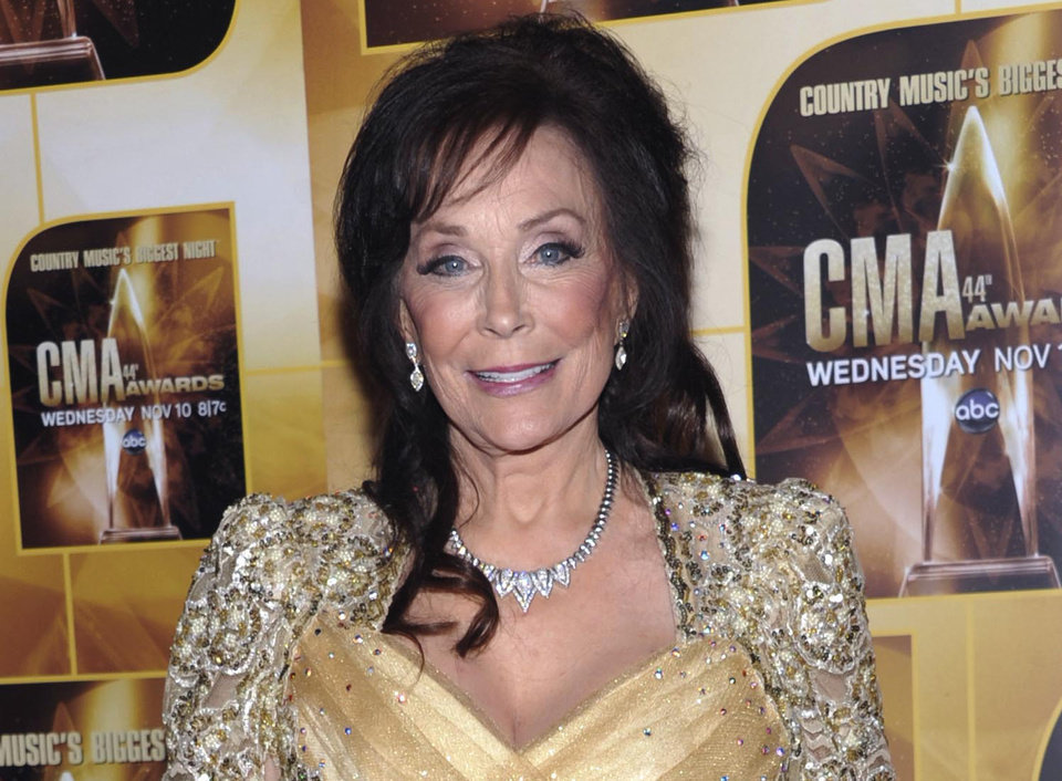 Photo - FILE - In this Nov. 10, 2010 file photo, singer Loretta Lynn poses in the press room during the 44th Annual Country Music Awards in Nashville, Tenn. Newly discovered documents indicate country music legend Loretta Lynn is three years older than she has led people to believe, a change that undermines the story told in