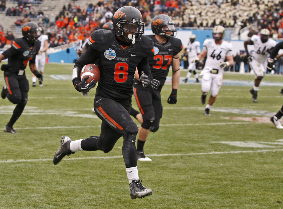 Photo - Oklahoma State's Daytawion Lowe (8) runs a fumble recovery back for a touchdown during the Heart of Dallas Bowl football game between Oklahoma State University and Purdue University at the Cotton Bowl in Dallas, Tuesday, Jan. 1, 2013. Oklahoma State won 58-14. Photo by Bryan Terry, The Oklahoman