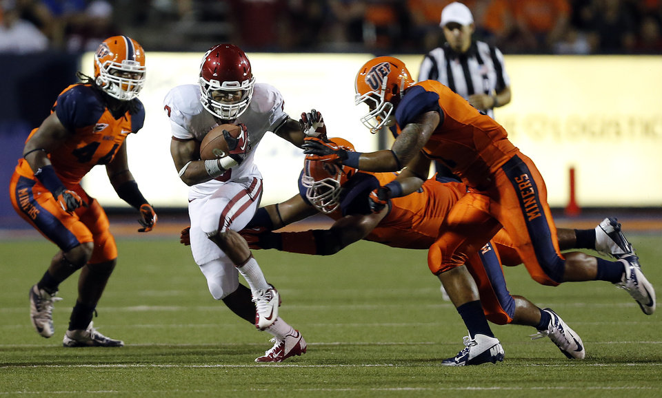 Photo - Oklahoma Sooners running back Dominique Whaley (8) runs past the UTEP defense during the college football game between the University of Oklahoma Sooners (OU) and the University of Texas El Paso Miners (UTEP) at Sun Bowl Stadium on Saturday, Sept. 1, 2012, in El Paso, Tex.  Photo by Chris Landsberger, The Oklahoman