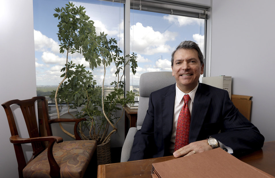 Roland Garcia, a partner at the law firm GreenbergTaurig poses in his office in Houston, Friday, Nov. 2, 2012. Americans living in predominantly wealthy, white neighborhoods account for nearly all the sizable campaign contributions in this year's presidential election, according to a new analysis by The Associated Press, even as President Barack Obama and Republican Mitt Romney have aggressively courted Hispanic voters, who are widely viewed as pivotal for victories in some battleground states on Election Day. (AP Photo/David J. Phillip)
