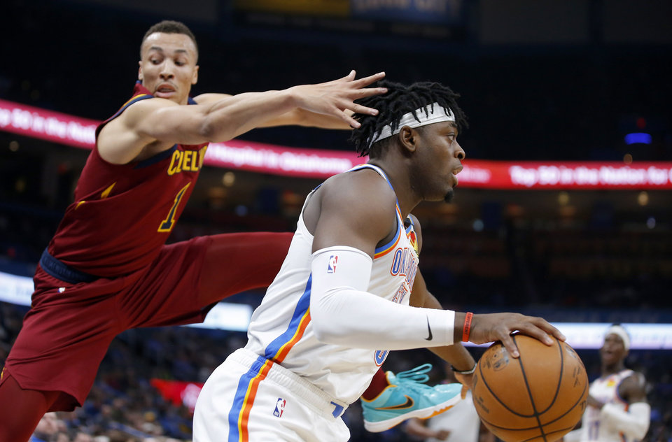 Photo - Oklahoma City's Luguentz Dort (5) goes past Cleveland's Dante Exum (1) during an NBA basketball game between the Oklahoma City Thunder and the Cleveland Cavaliers at Chesapeake Energy Arena in Oklahoma City, Wednesday, Feb. 5, 2020. [Bryan Terry/The Oklahoman]
