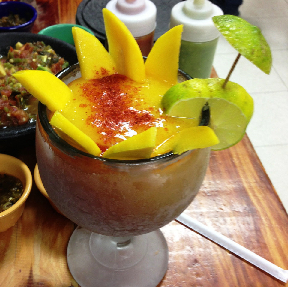 Photo - Chef Santos Flores offers mango smoothies with Salsa Chamoy at Abel's Mexican Restaurant in Warr Acres.  DAVE CATHEY - THE OKLAHOMAN