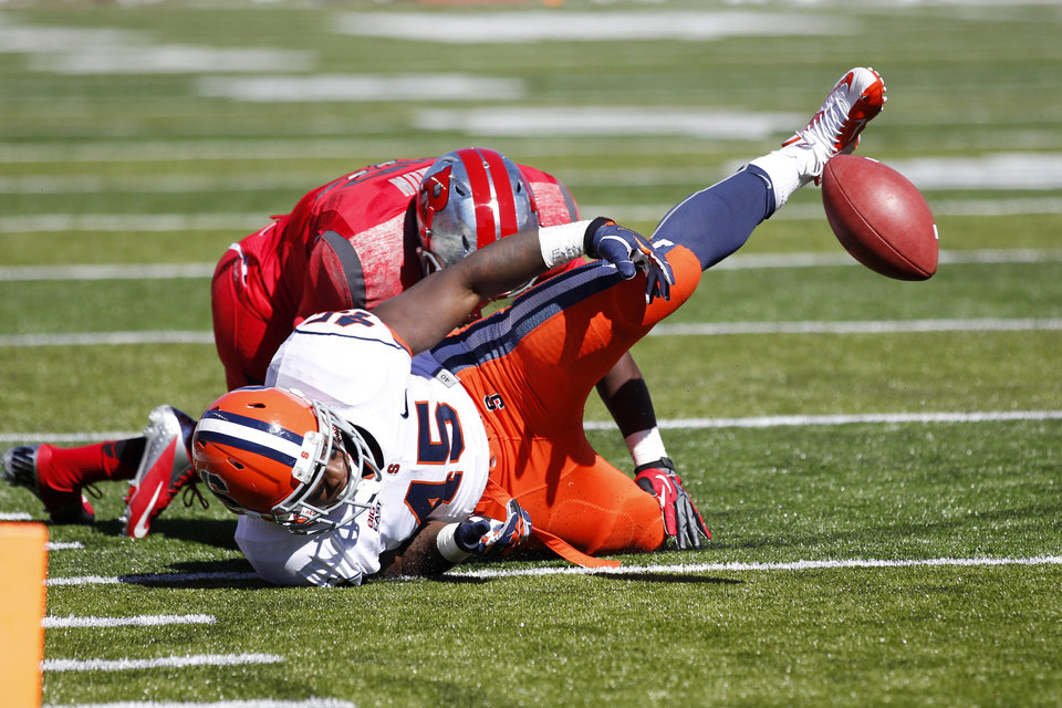 Photo -   Syracuse running back Jerome Smith (45) loses the ball as Rutgers defensive back Duron Harmon makes a tackle during the first half of an NCAA college football game at High Points Solutions stadium in Piscataway, N.J., Saturday, Oct. 13, 2012. (AP Photo/Mel Evans)
