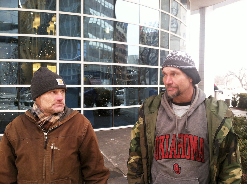 Charles Scott, left, and Jeff Hancock, who are homeless, talk Friday outside the Ronald J. Norick Downtown Library. Photo by Phillip O'Connor, The Oklahoman