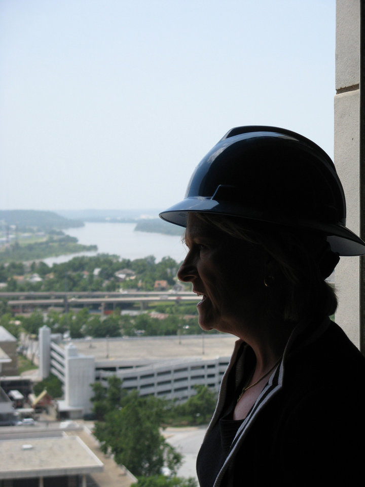 Photo - RENOVATE /RENOVATION: Tulsa Mayor Kathy Taylor surveys the view from an open window of the Mayo Hotel. BY STEVE LACKMEYER, THE OKLAHOMAN ORG XMIT: 0807012212090135 ORG XMIT: 6083QI2