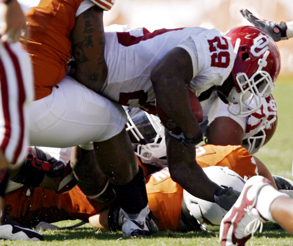 Photo - Oklahoma's Chris Brown is stopped on a fourth and one attempt by the Sooners during the Red River Rivalry college football game between the University of Oklahoma Sooners (OU) and the University of Texas Longhorns (UT) at the Cotton Bowl in Dallas, Texas, Saturday, Oct. 17, 2009. Photo by Chris Landsberger, The Oklahoman