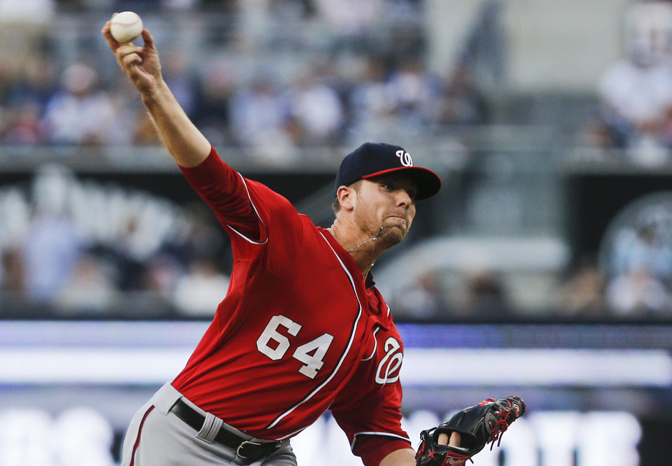 Photo - Washington Nationals starter Blake Treinen works against the San Diego Padres during the first inning of a baseball, game Saturday, June 7, 2014, in San Diego. (AP Photo/Lenny Ignelzi)