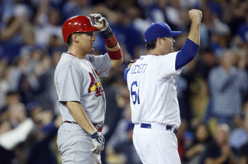 Photo - St. Louis Cardinals' Jon Jay reacts to being called out at home plate as Los Angeles Dodgers starting pitcher Josh Beckett, right, celebrates during the seventh inning of a baseball game, Thursday, June 26, 2014, in Los Angeles. The play was reviewed, and the call stood. (AP Photo/Danny Moloshok)