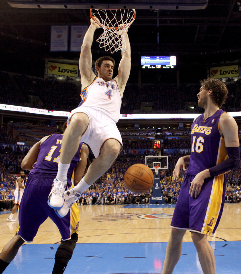 Photo - Oklahoma City's Nick Collison (4) dunks the ball between Los Angeles' Andrew Bynum (17), and Los Angeles' Pau Gasol (16) during Game 5 in the second round of the NBA playoffs between the Oklahoma City Thunder and the L.A. Lakers at Chesapeake Energy Arena in Oklahoma City, Monday, May 21, 2012. Oklahoma City won 106-90.  Photo by Bryan Terry, The Oklahoman