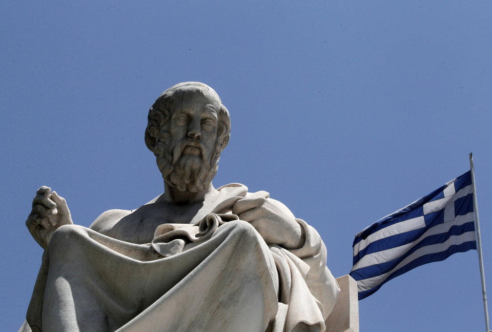 Photo -   FILE- In this June 5, 2012, file photo, the marble statue of ancient Greek philosopher Plato, stands in front of the Athens Academy, as the Greek flag flies in Athens. Bankers, governments and investors are starting to prepare for Greece to drop the euro currency, a move that could spread turmoil throughout the global financial system. A Greek election on Sunday, June 12, 2012, will go a long way toward determining whether it happens. (AP Photo/Dimitri Messinis, File)