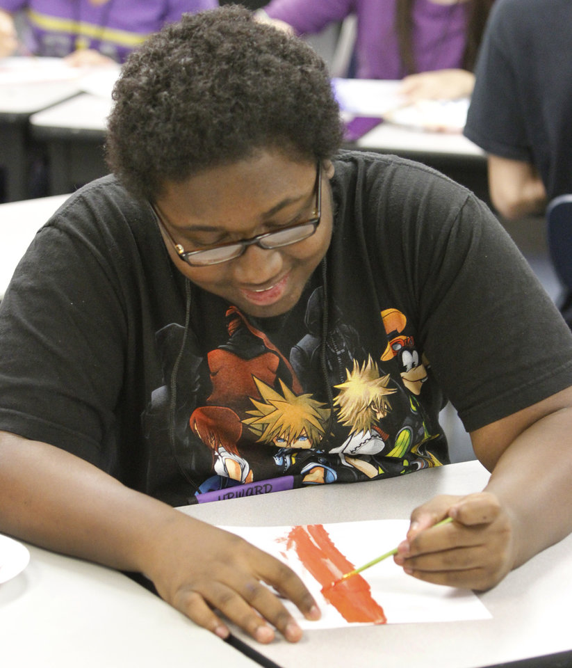 Terrion Frazier, 16, paints during his art class in Oklahoma City Community College's TRIO Upward Bound program in Oklahoma City, Monday, June 11, 2012. Photo By Steve Gooch, The Oklahoman