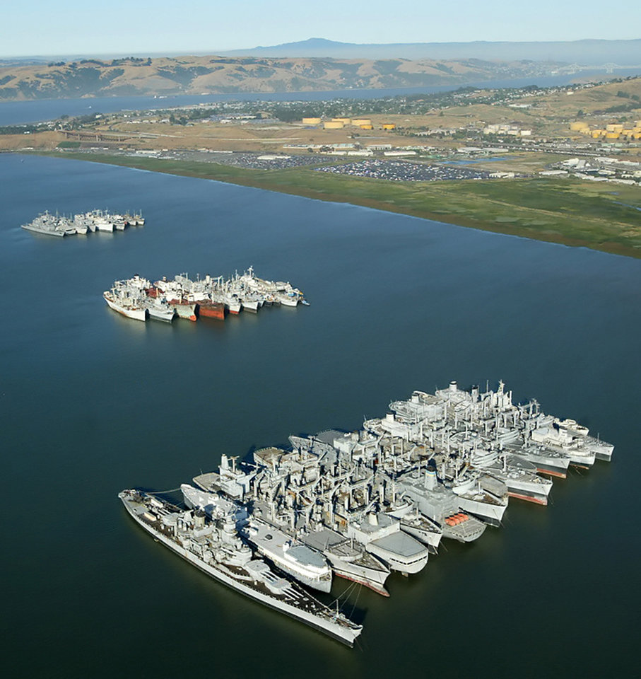 Photo -   FILE - In this July 18, 2003 file photo, the battleship USS Iowa, bottom left, sits anchored with the mothball fleet in Suisun Bay, Calif. The 887-foot long ship that once carried President Franklin Roosevelt to a World War II summit to meet with Churchill and Stalin is coming to life once again for what is most likely her final voyage this month to become a floating museum in Los Angeles. (AP Photo/Eric Risberg, File)