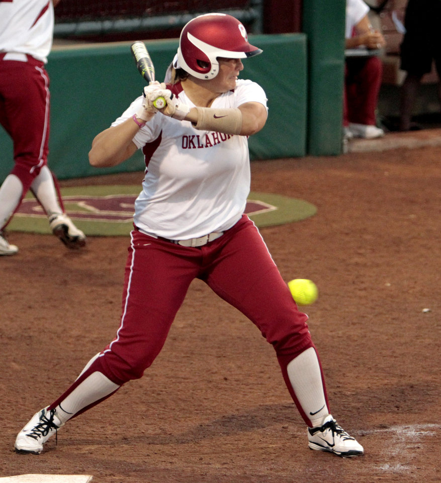 Sooner Katie Norris is hit by a pitch from starting pitcher Simone Freeman as the University of Oklahoma (OU) Sooners play the Oklahoma State University Cowgirls in NCAA college softball at Marita Hines Field on Wednesday, April 25, 2012, in Norman, Okla.  Photo by Steve Sisney, The Oklahoman