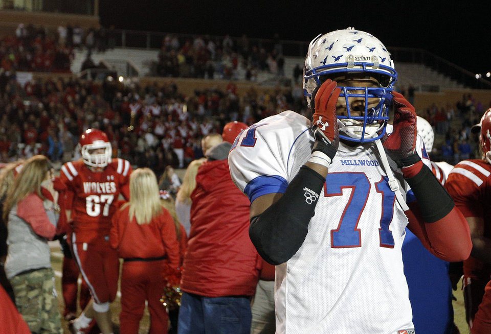 Photo - Millwood's Josh Little reacts after losing to Davis in the Class 2A state football championship game  at Moore High School in Moore, Okla.,  Thursday, Dec. 19, 2013. Photo by Sarah Phipps, The Oklahoman