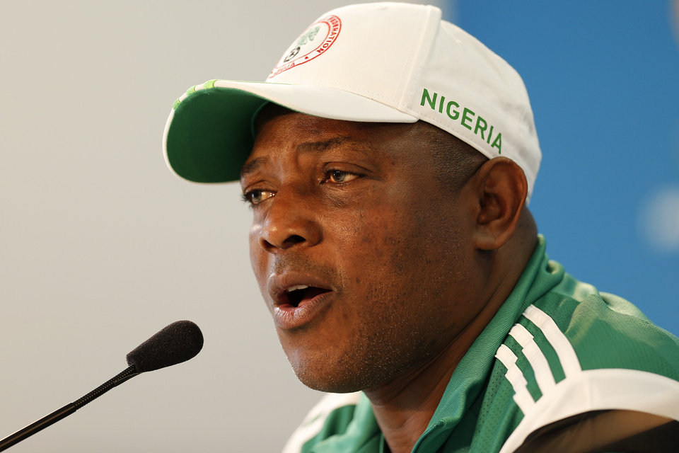 Photo - Nigeria's coach Stephen Keshi speaks during a news conference at Beira-Rio Stadium in Porto Alegre, Brazil, Tuesday, June 24, 2014.  Nigeria plays in group F of the 2014 soccer World Cup. (AP Photo/Victor R. Caivano)