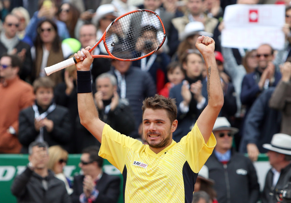 Photo - Stanislas Wawrinka of Switzerland celebrates after defeating David Ferrer of Spain, during their semifinal match of the Monte Carlo Tennis Masters tournament in Monaco, Saturday, April, 19, 2014. Wavrinka won 6-1, 7-6. (AP Photo/Claude Paris)