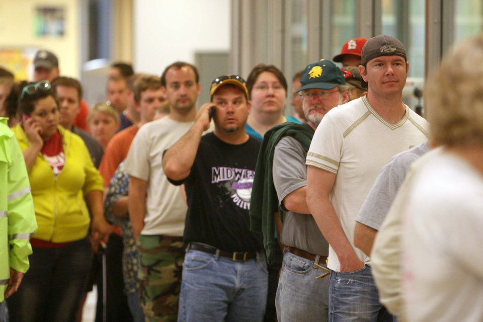 Photo - Would-be volunteers wait in line for a work assignments at Missouri Southern State University in Joplin, Mo., Monday, May 23, 2011. Hundreds of people turned out to offer their assistance the morning after a destructive tornado moved through Joplin, killing at least 89 people and injuring hundreds more. (AP Photo/Mark Schiefelbein) ORG XMIT: MOMS104