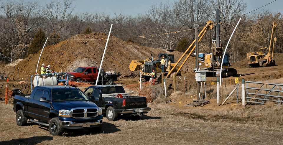 Crews work Feb. 4 on a section of the Keystone Pipeline where a woman locked herself to the pipeline in protest to protect Oklahoma waterways from Tar Sands.  Photo by Chris Landsberger, The Oklahoman <strong>CHRIS LANDSBERGER - CHRIS LANDSBERGER</strong>
