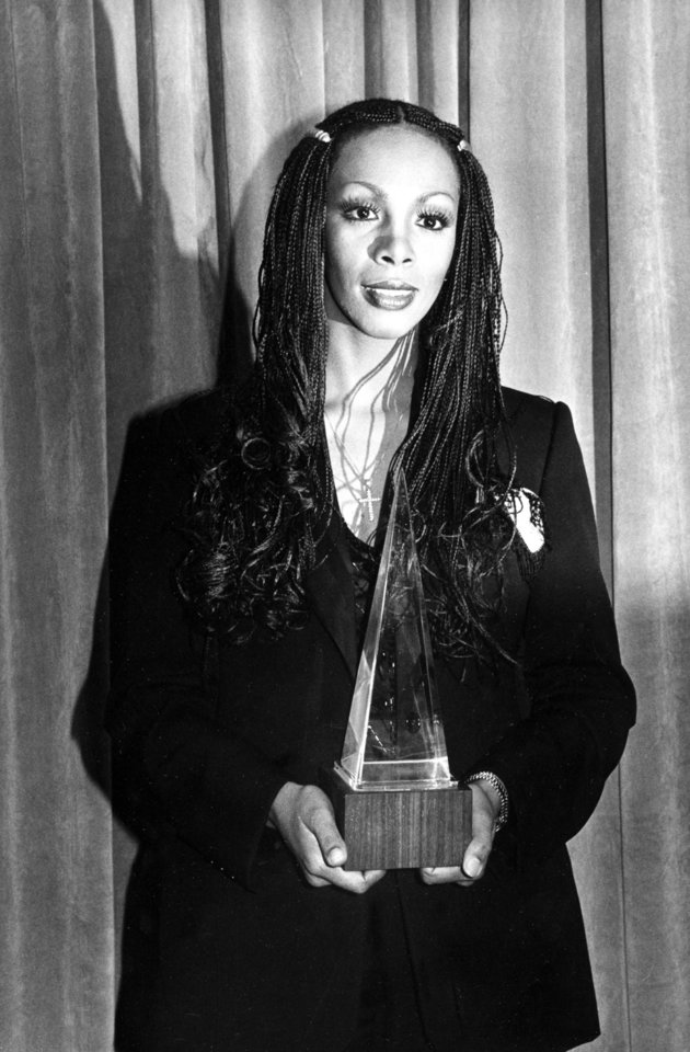 "Photo -   FILE - In this Jan. 18, 1980 file photo, Donna Summer poses with her award at the American Music Awards in Los Angeles, Calif. Summer, the Queen of Disco who ruled the dance floors with anthems like ""Last Dance,"" ""Love to Love You Baby"" and ""Bad Girl,"" has died. Her family released a statement, saying Summer died Thursday, May 17, 2012. She was 63. (AP Photo/Nick Ut, File)"