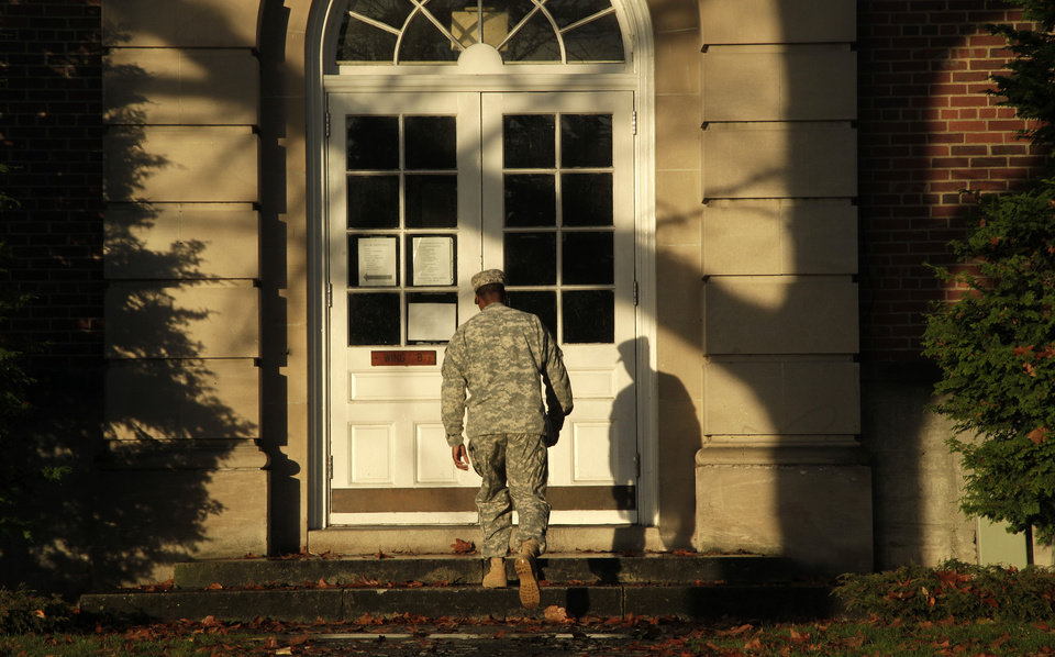 Photo -   A soldier walks outside the building housing a military courtroom on Joint Base Lewis McChord in Washington state, where a preliminary hearing was expected to conclude Tuesday Nov. 13, 2012, for U.S. Army Staff Sgt. Robert Bales. Bales is accused of 16 counts of premeditated murder and six counts of attempted murder for a pre-dawn attack on two villages in Kandahar Province in Afghanistan last March. (AP Photo/Ted S. Warren)