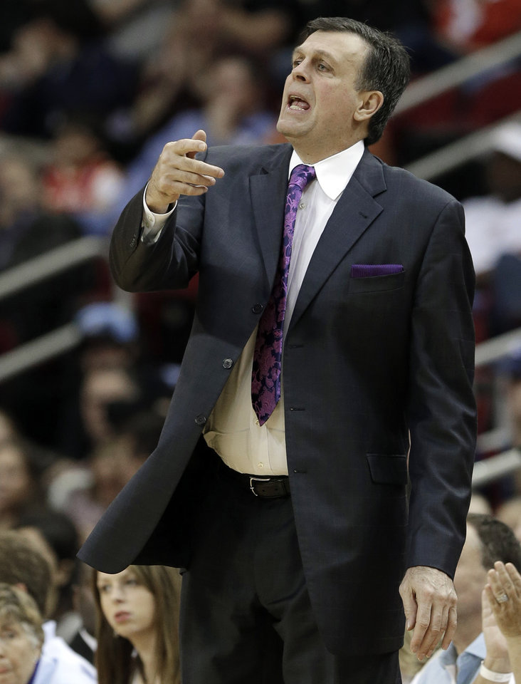 Photo - Houston Rockets coach Kevin McHale yells to his players in the first half of an NBA basketball game against the Minnesota Timberwolves Friday, March 15, 2013, in Houston. (AP Photo/Pat Sullivan)