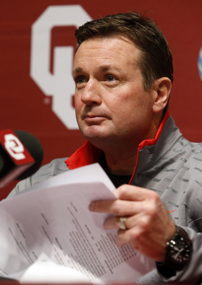 University of Oklahoma head football coach Bob Stoops looks over recruit biographies before he speaks at a press conference on National Signing Day at OU on Wednesday, Feb. 6, 2013, in Norman, Okla.  Photo by Steve Sisney, The Oklahoman