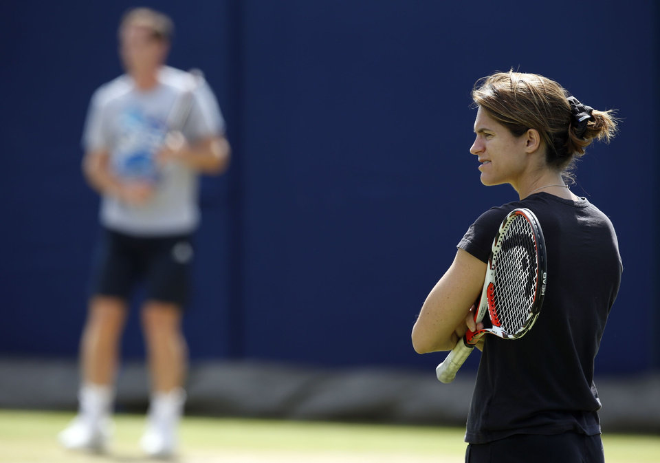 Photo - Andy Murray, left, is joined by new coach Amelie Mauresmo, during a practice session at The Queen's Club in London, Wednesday June 11, 2014. Murray starts the defence of his Queen's Club tournament tournament Wednesday, just hours after the training session with his new coach Mauresmo. (AP Photo / Jonathan Brady, PA) UNITED KINGDOM OUT - NO SALES - NO ARCHIVES