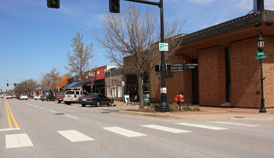 Photo - Broadway and 1st Street, downtown in Edmond, Wednesday, March 18, 2020.  [Photo by Doug Hoke/The Oklahoman]