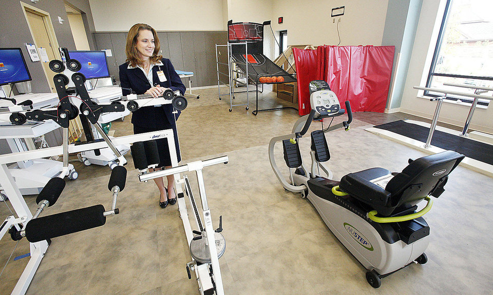 Photo - Sharon Smeltzer, Mercy Rehabilitation  Hospital CEO and Administrator, looking at equipment in he main physical therapy gym at Mercy Rehabilitation  Hospital, 5401 W. Memorial Road, in Oklahoma City Friday, Sept. 28, 2012. Photo by Paul B. Southerland, The Oklahoman