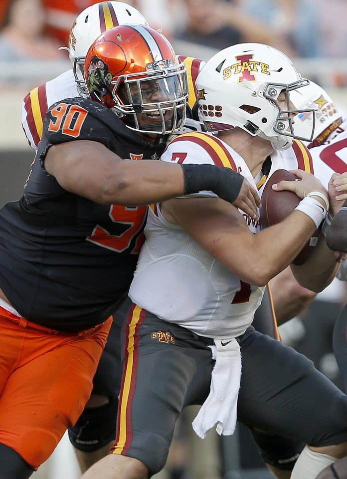 Photo - Oklahoma State's Motekiai Maile (90) celebrates a sacks Iowa State's Joel Lanning (7) in the fourth quarter during a college football game between the Oklahoma State University Cowboys (OSU) and the Iowa State University at Boone Pickens Stadium in Stillwater, Okla., Saturday, Oct. 8, 2016. Photo by Sarah Phipps, The Oklahoman