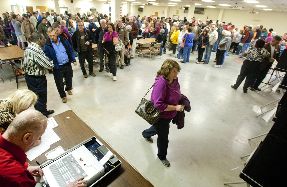 Photo -   Voters wait in line for over an hour to vote at the Moose Lodge polling site in Campbell County on Tuesday, Nov. 6, 2012, in Lynchburg, Va. (AP Photo/News & Daily Advance, Jill Nance)