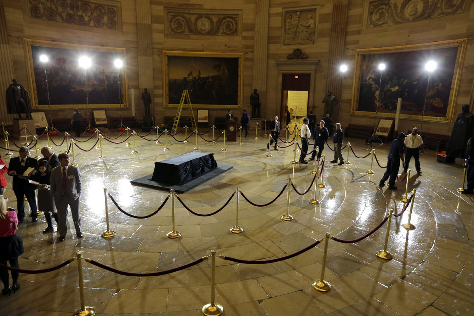 Photo - Preparations are made for Senate President Pro Tempore Daniel K. Inouye, D-Hawaii, to lie in state Thursday in the U.S. Capitol Rotunda, on Capitol Hill Wednesday, Dec. 19, 2012 in Washington. (AP Photo/Alex Brandon)