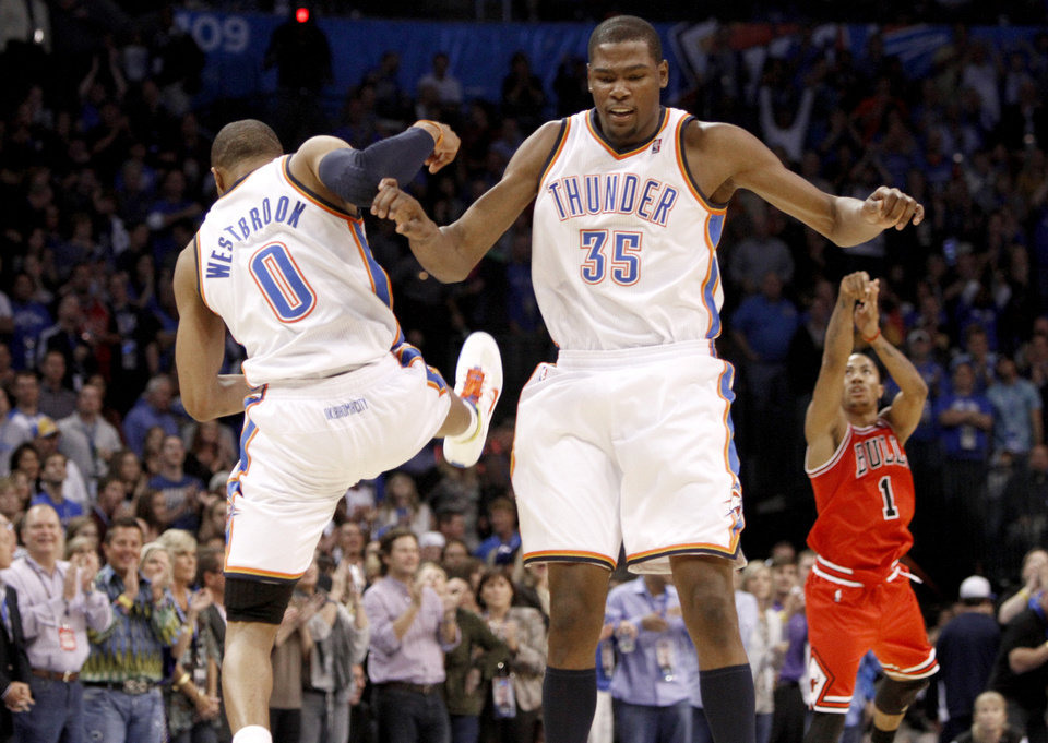 Photo - Oklahoma City's Russell Westbrook and Kevin Durant celebrate during the NBA basketball game between the Oklahoma City Thunder and the Chicago Bulls in the Oklahoma City Arena on Wednesday, Oct. 27, 2010. Photo by Bryan Terry, The Oklahoman