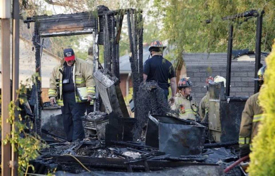 Photo - Oklahoma City firemen investigating a fatality house fire at 1310 SW 23 Street in Oklahoma City Tuesday, April 22, 2014. Photo by Paul B. Southerland, The Oklahoman