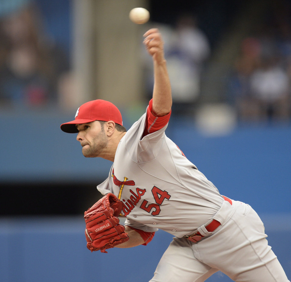 Photo - St. Louis Cardinals starter Jamie Garcia pitches to the Toronto Blue Jays during a baseball game in Toronto, Sunday, June 8, 2014. (AP Photo/The Canadian Press, Frank Gunn)