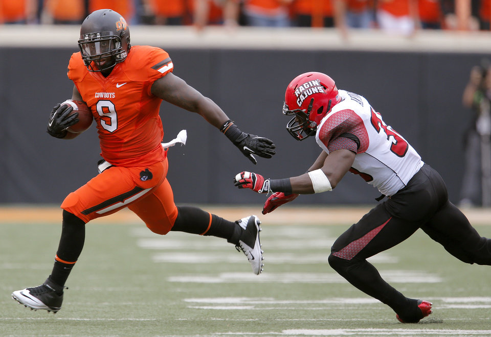 Oklahoma State's Kye Staley (9) tries to get by Louisiana-Lafayette's Boris Anyama (35) during a college football game between Oklahoma State University (OSU) and the University of Louisiana-Lafayette (ULL) at Boone Pickens Stadium in Stillwater, Okla., Saturday, Sept. 15, 2012. Photo by Sarah Phipps, The Oklahoman
