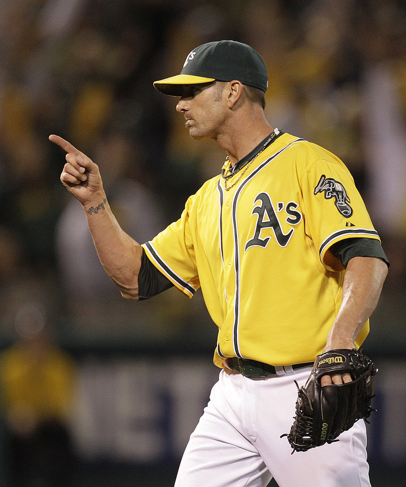 Photo -   Oakland Athletics' Grant Balfour celebrates at the end of a baseball game against the Baltimore Orioles, Saturday, Sept. 15, 2012, in Oakland, Calif. (AP Photo/Ben Margot)