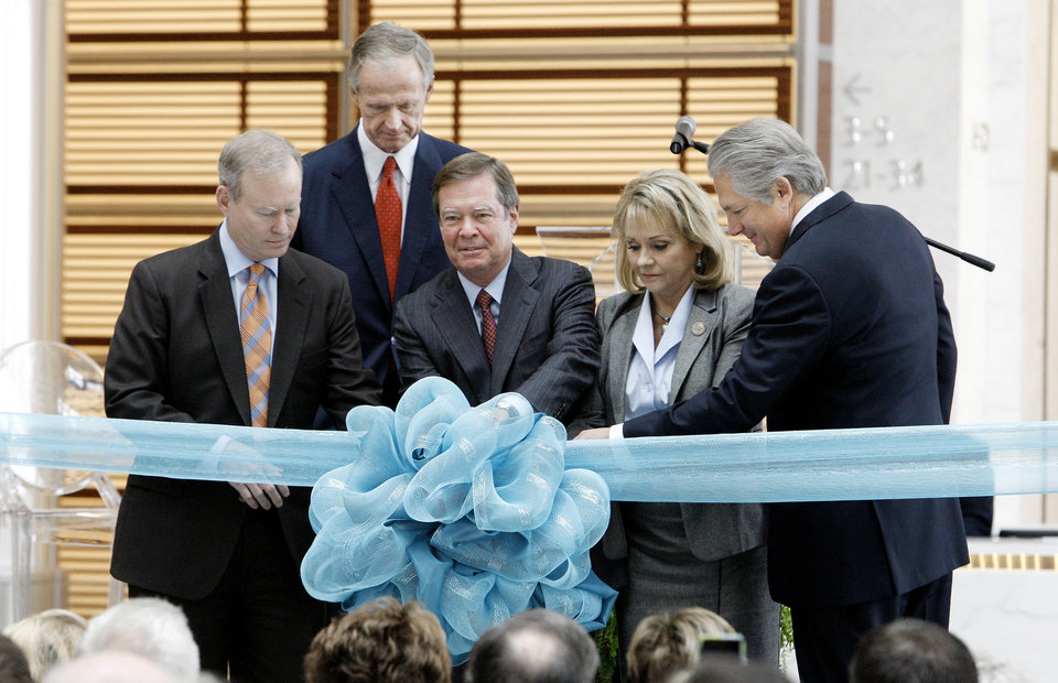 Larry Nichols, center, Devon Energy executive chairman, pulling a pin on a ribbon during a commemoration ceremony of the Devon Energy Center in Oklahoma City Tuesday, Oct. 23, 2012. From left are Mayor Mick Cornett, John Richels, Devon president and CEO, Larry Nichols, Gov. Mary Fallin and Jon Pickard, building architect. After six years of planning and three years of construction Devon Energy held a ceremony commemorating the completion of the center. Photo by Paul B. Southerland, The Oklahoman