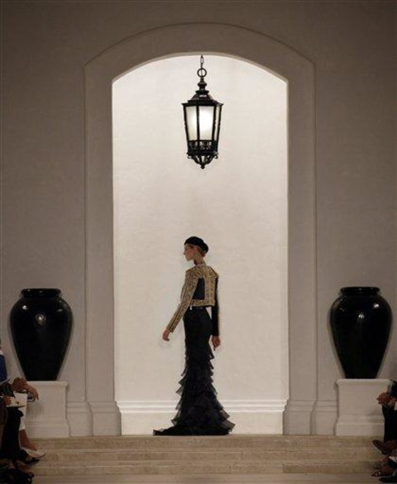 Photo - The Ralph Lauren Spring 2013 collection is modeled during Fashion Week in New York,  Thursday, Sept. 13, 2012. (AP Photo/Richard Drew)