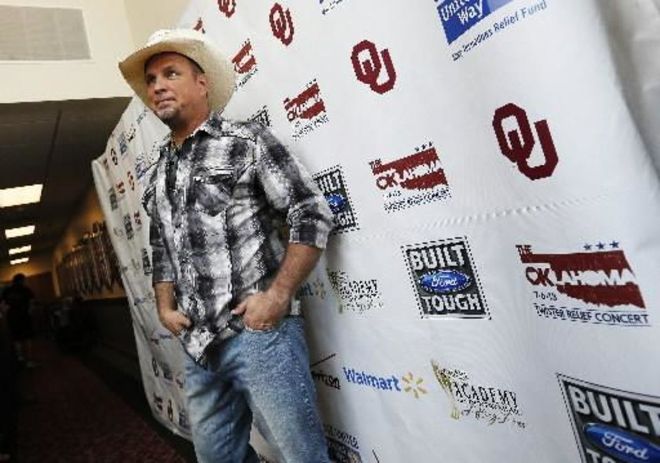 Photo -  Garth Brooks poses for photographers backstage during the Oklahoma Twister Relief Concert, benefiting victims of the May tornadoes, at Gaylord Family - Oklahoma Memorial Stadium on the campus of the University of Oklahoma in Norman, Okla., Saturday, July 6, 2013. Photo by Nate Billings, The Oklahoman