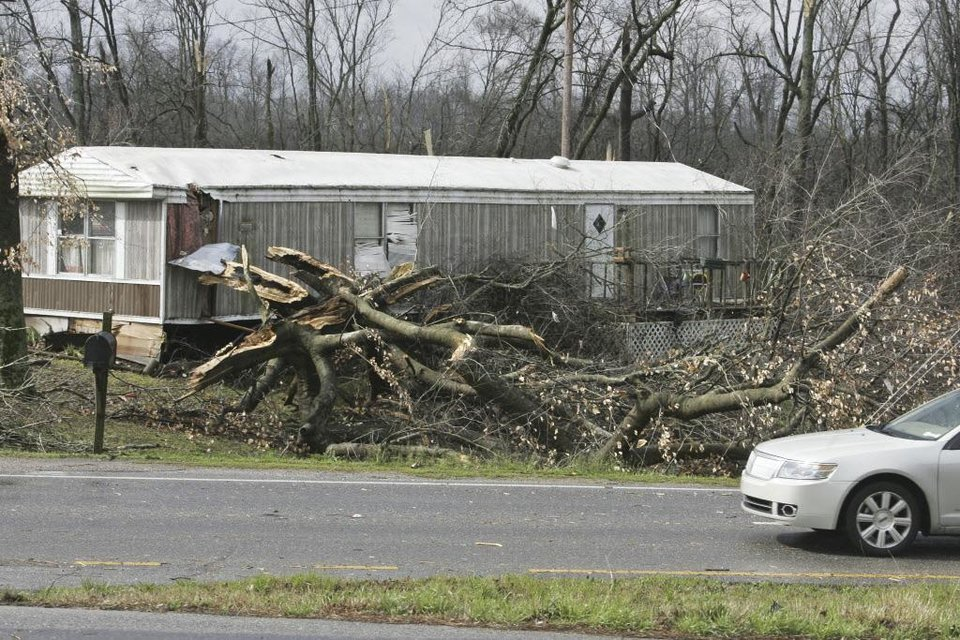 A tree falls in front of a mobile home after severe weather passed through on US Highway 72 West in Athens, Ala.  Friday March 2, 2012 A reported tornado destroyed several houses in northern Alabama as storms threatened more twisters across the region Friday. (AP Photo/The Huntsville Times, Robin Conn)  ORG XMIT: ALHUT119
