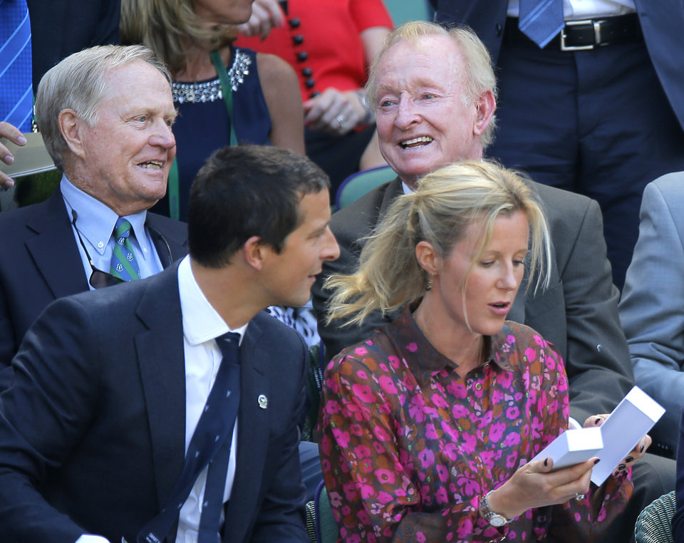 Photo - Former golfer Jack Nicklaus, rear left, and former tennis player Rod Laver, rear right, sit in the Royal Box on centre court prior to the men's singles semifinal match between Novak Djokovic of Serbia and Grigor Dimitrov of Bulgaria at the All England Lawn Tennis Championships in Wimbledon, London, Friday July 4, 2014. (AP Photo/Pavel Golovkin)