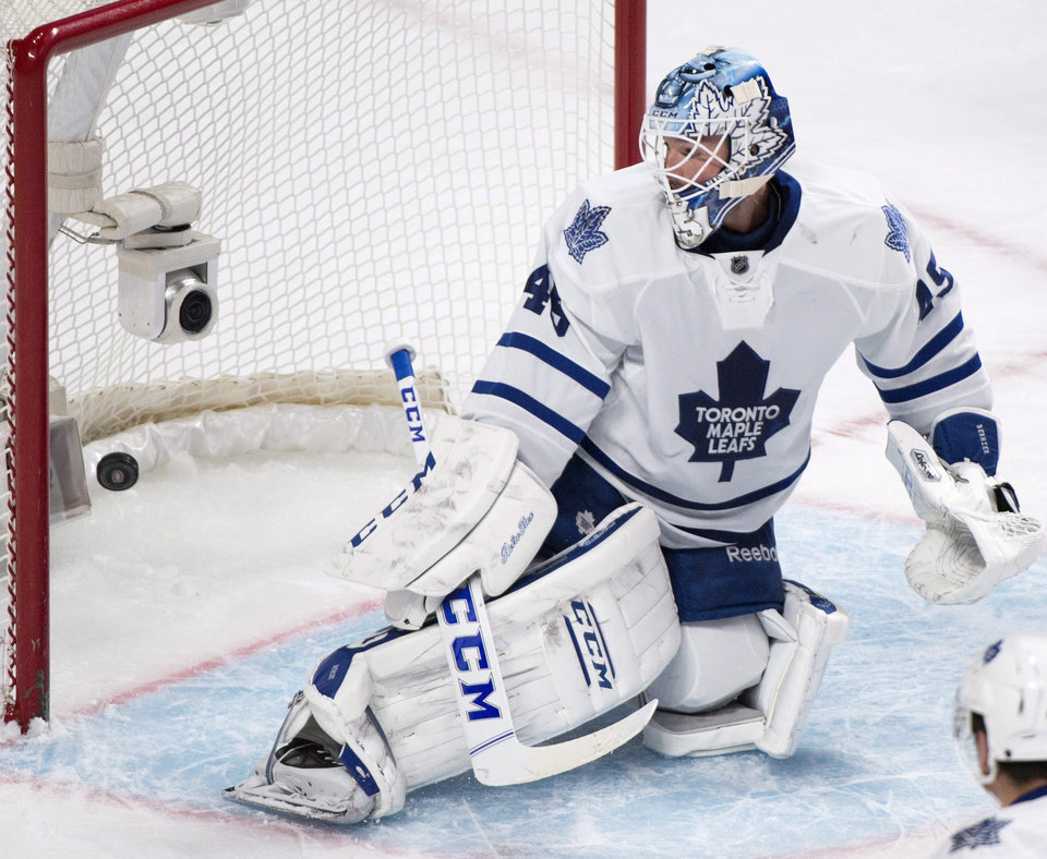 Photo - Toronto Maple Leafs goaltender Jonathan Bernier is scored on by Montreal Canadiens' Alex Galchenyuk during the first period of an NHL hockey game in Montreal, Saturday, March 1, 2014. (AP Photo/The Canadian Press, Graham Hughes)