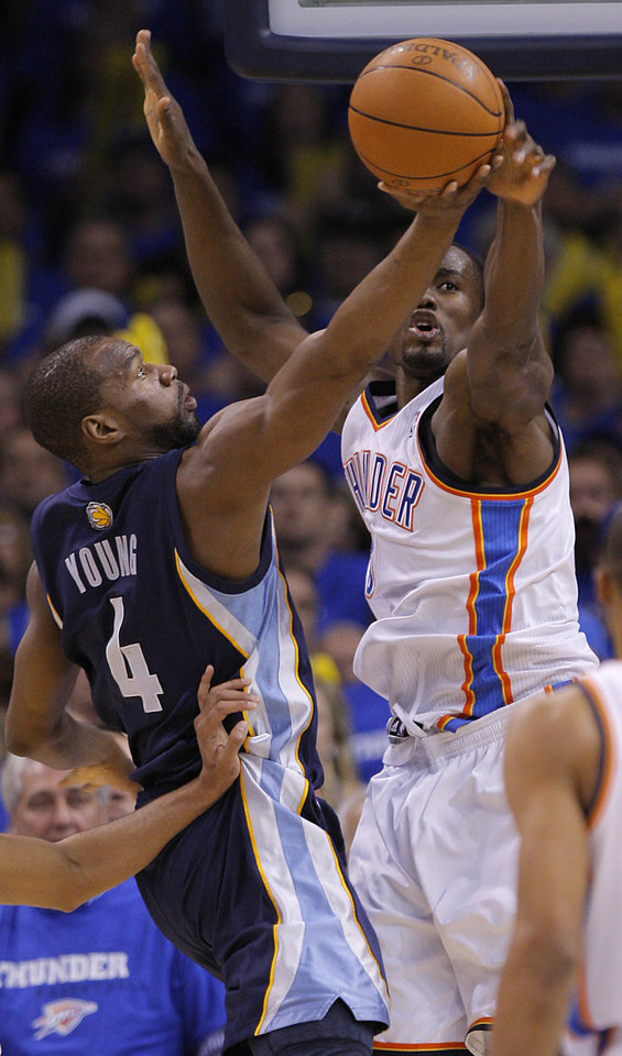 Oklahoma City's Serge Ibaka (9) defends on Sam Young (4) of Memphis during game two of the Western Conference semifinals between the Memphis Grizzlies and the Oklahoma City Thunder in the NBA basketball playoffs at Oklahoma City Arena in Oklahoma City, Tuesday, May 3, 2011. Photo by Bryan Terry, The Oklahoman