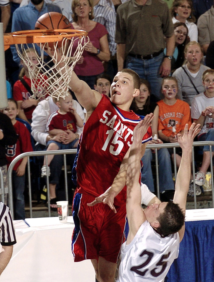 Oklahoma Christian's Blake Griffin (15) scores  against Sequoyah-Tahlequah's Heath Horawa (25) in the first quarter of the OSSAA Class 3A State Championship finals at the State Fair Arena, in Oklahoma City, Saturday, March 12, 2005.  By Bill Waugh/The Oklahoman