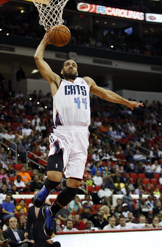 Photo -   Charlotte Bobcat's Jeffery Taylor (44) drives for a dunk against the Miami Heat during the first half of an NBA preseason basketball game in Raleigh, N.C., Tuesday, Oct. 23, 2012. (AP Photo/Gerry Broome)